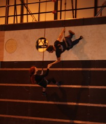 Aerialists rehearse a spectacular scene on the side of the ship