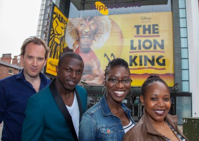 cast members (L-R) Gugwana Dlamini (Rafiki), Carole Stennett (Nala), Nicholas Nkuna (Simba) and Stephen Carlile (Scar) arrive at the theatre..
